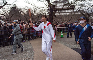 Tokyo Olympic torch staffer becomes event's first COVID-19 infection