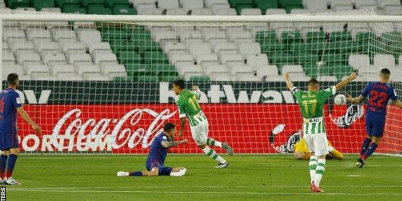 Atletico go top of La Liga with laboured draw against Betis