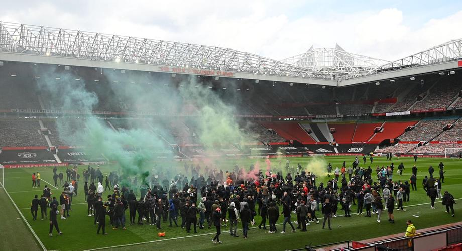 Manchester United fans mount protest against US owners as Premier League match against Liverpool postponed