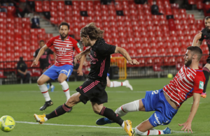 Real sink Granada to keep pressure on Atletico