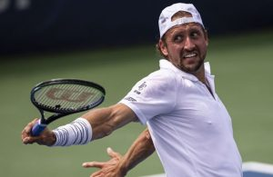 Sandgren hit in groin, defaults after striking line judge with ball